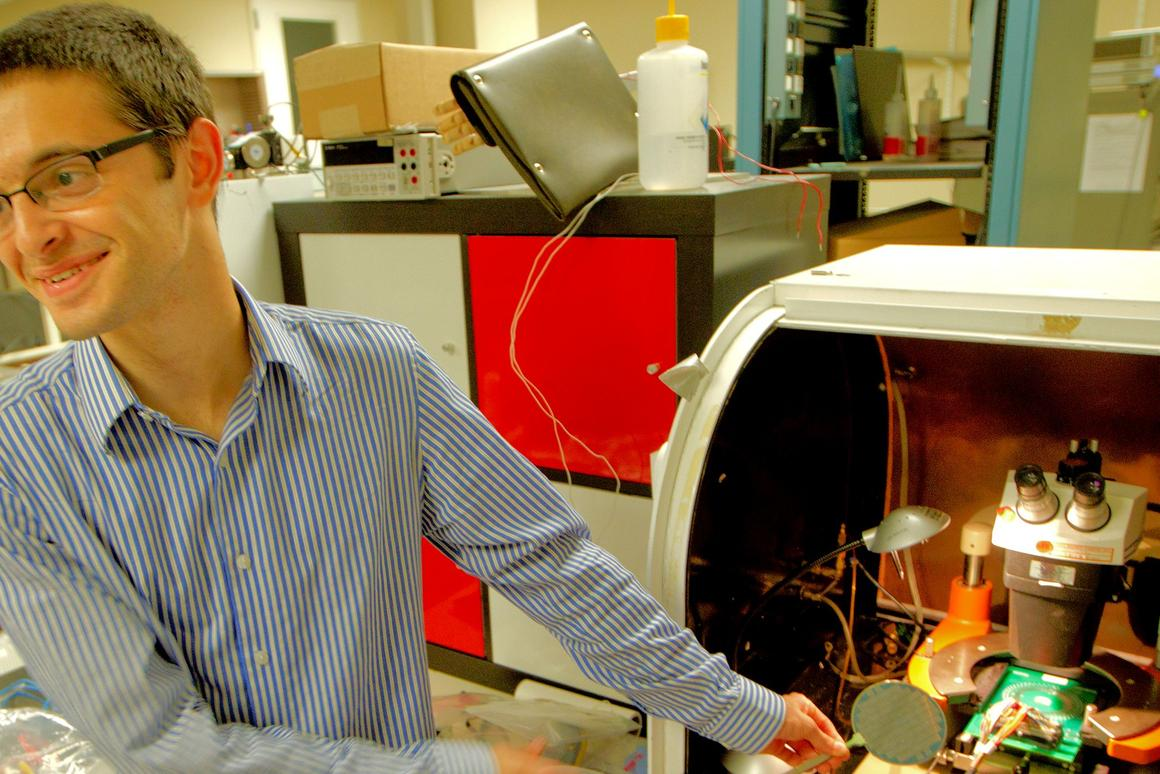 Stanford EE graduate student Max Schulaker holds a silicon wafer on which have been grown a number of CNT-based computer chips (Photo: Norbert von der Groben/Stanford)