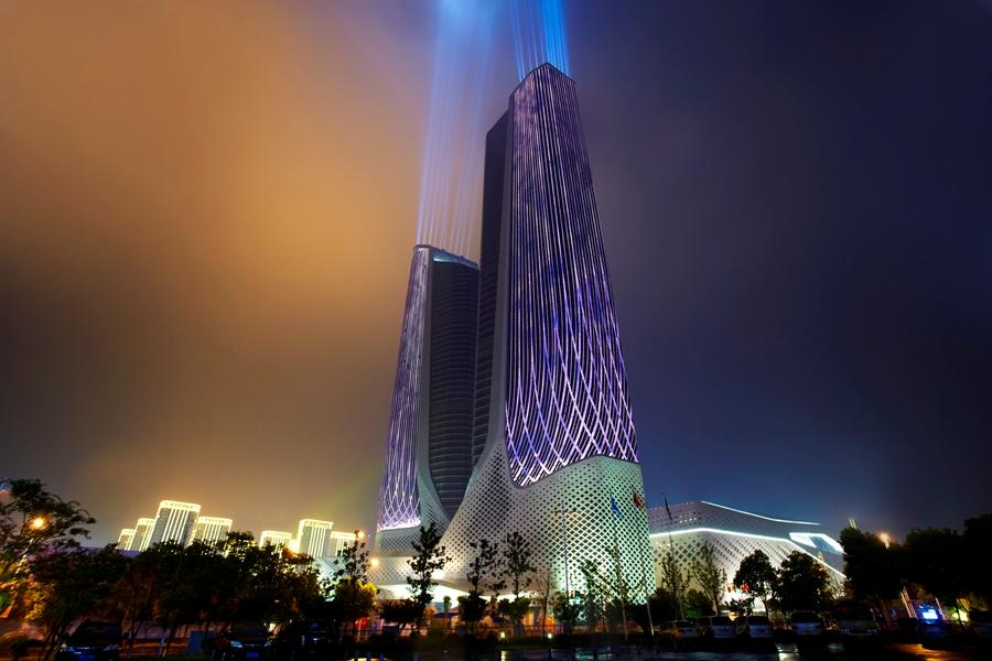 The International Youth Culture Centre in Nanjing, China, is illuminated using 700,000 LED nodes, LED linear lighting and LED flood lighting