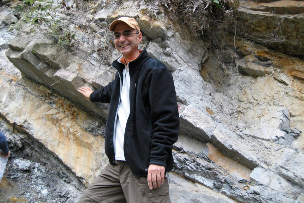 MIT professor of geophysics Daniel Rothman stands next to part of the Xiakou formation in China (Photo: Daniel Rothman)