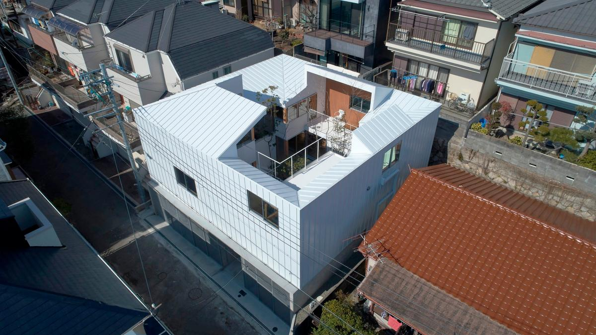 Tomohiro Hata Architect and Associates have made a hidden garden thecentral focus of the Loop House