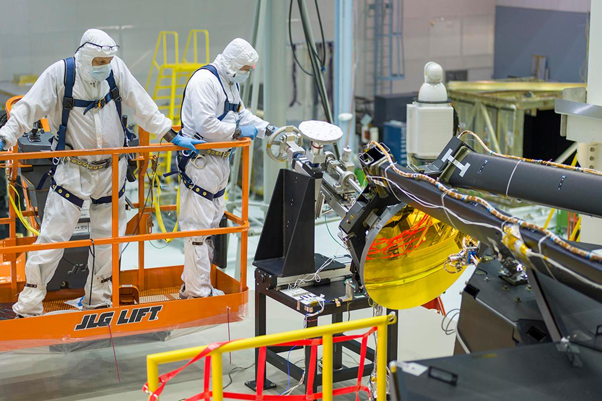 NASA engineers install the JWST's secondary mirror