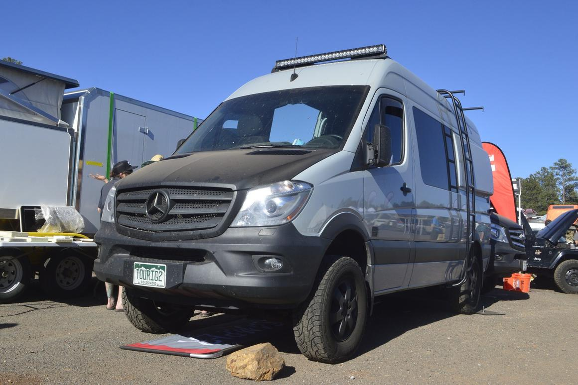 TouRig's Terracamper Sprinter has a folding bed like the Vansports Camper, also a Terracamper-based conversion, but without the greater tuner-car, high-performance aesthetic