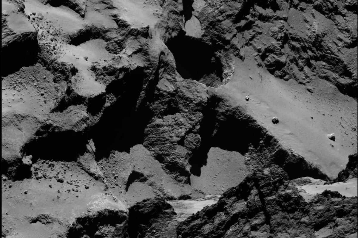 An active sinkhole (center) on 67P