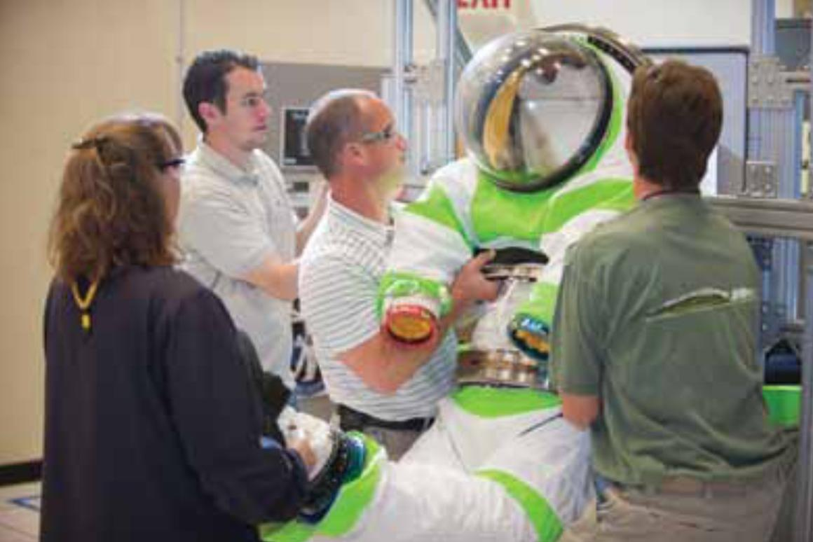The Z-1 space suit has a rear entry hatch that can latch to a spaceship or rover, eliminating the need for an airlock