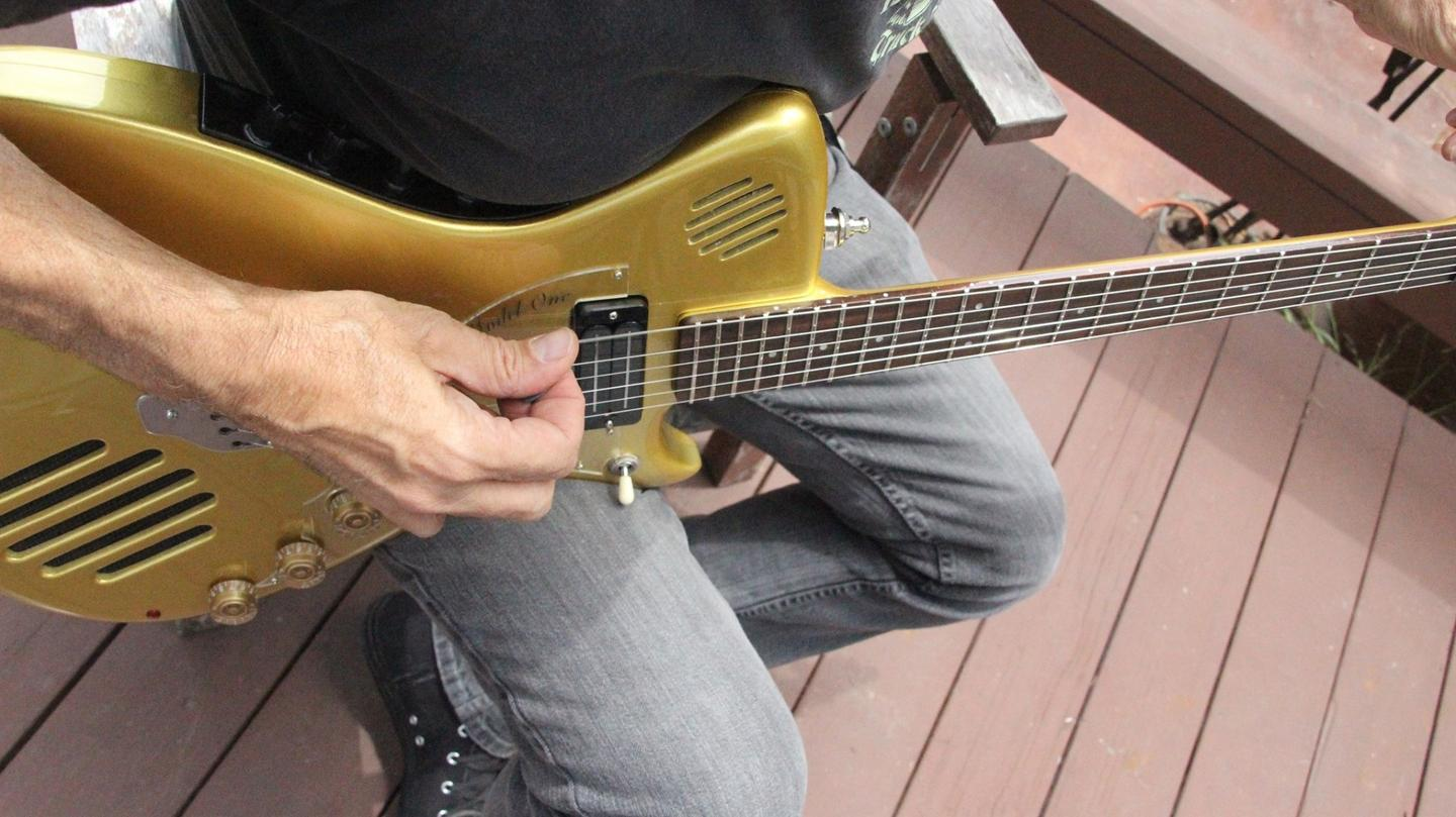 String action is caught in the act by a humbucker bridge pickup and a choice of P90, mini humbucker or single coil neck pickup