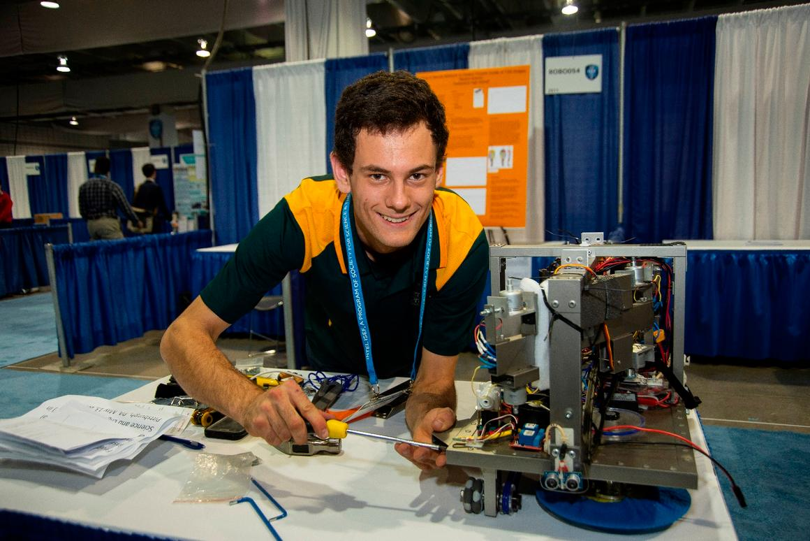 Oliver Nicholls, recipient of the2018Gordon E Moore Award at the IntelInternational Science and Engineering Fair, with his prize-winning automated robotic window cleaner prototype