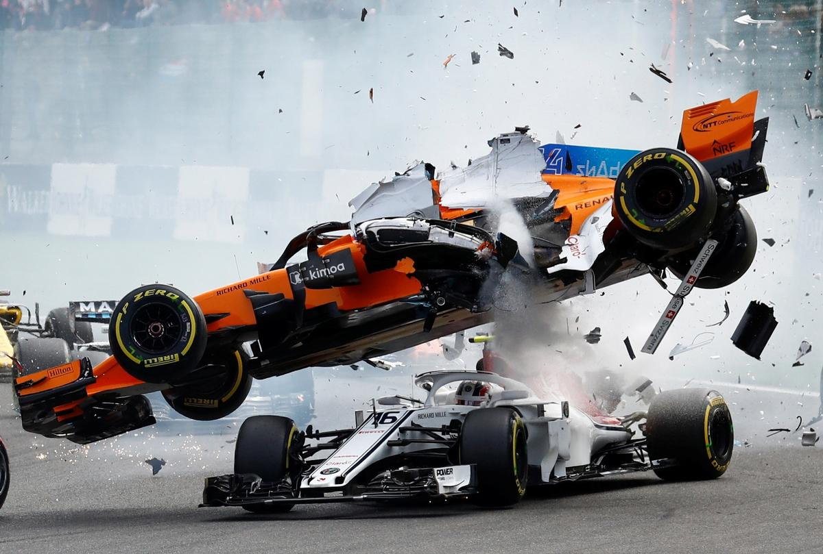 McLaren's Fernando Alonso and Sauber's Charles Leclerc crash at the first corner during the Belgian Grand Prix in Spa-Francorchamps, Belgium, August 26, 2018
