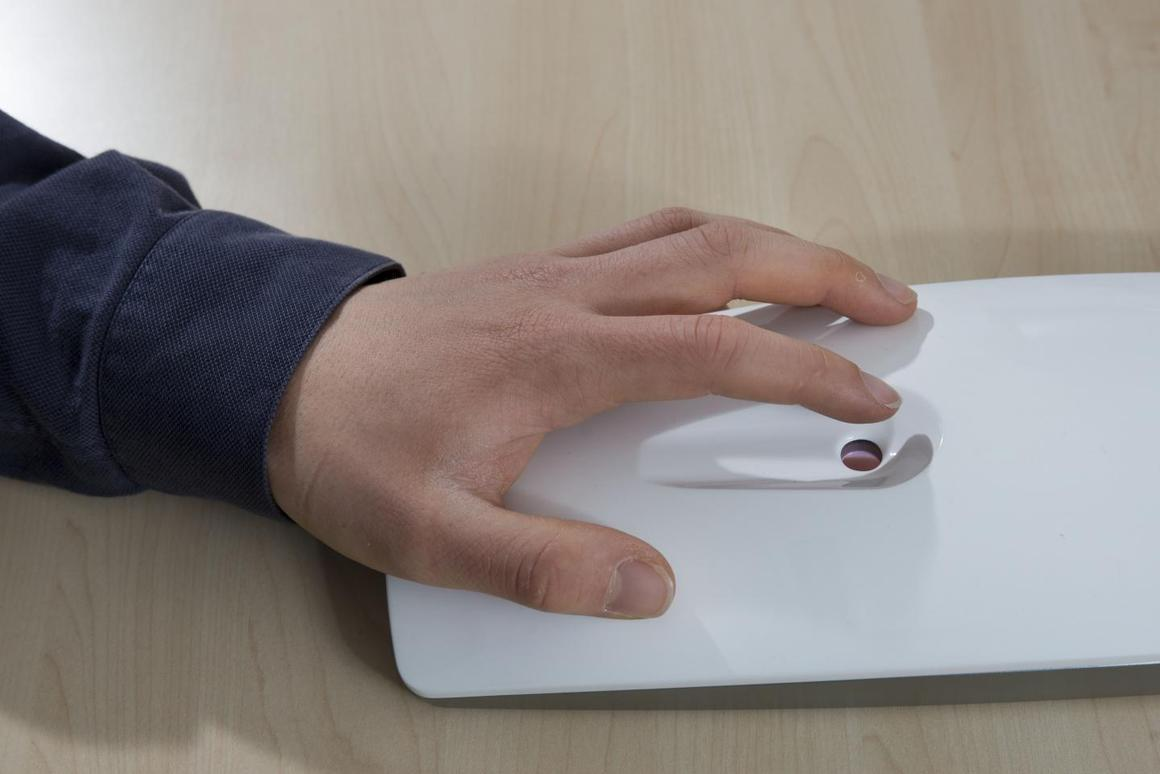 The GlucoSense device in use – not a finger-lance in sight