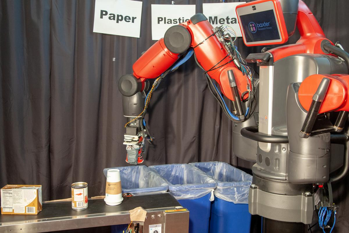 A Baxter robot uses the RoCycle hand to sort objects for recycling