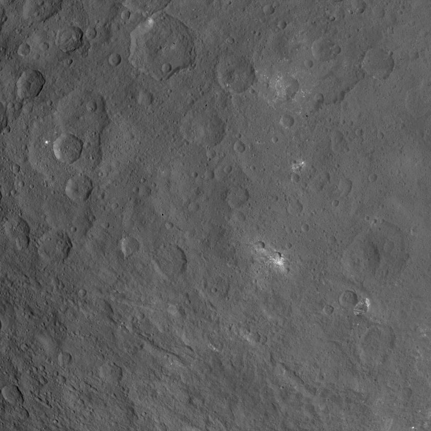 Surface image of Ceres' unusual mountain (featured near the bottom right), and several bright spots