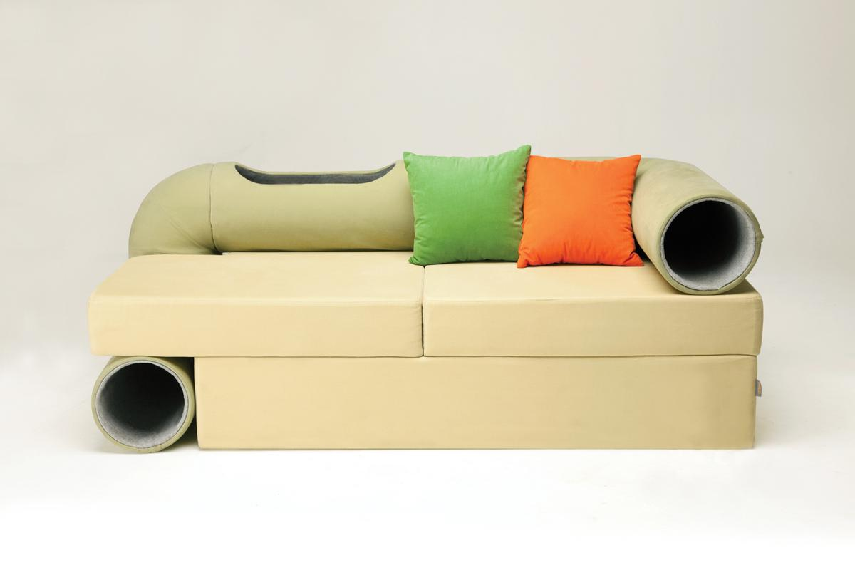 The Cat Tunnel Sofa features a play tunnel that runs along the arm, back and side of the sofa