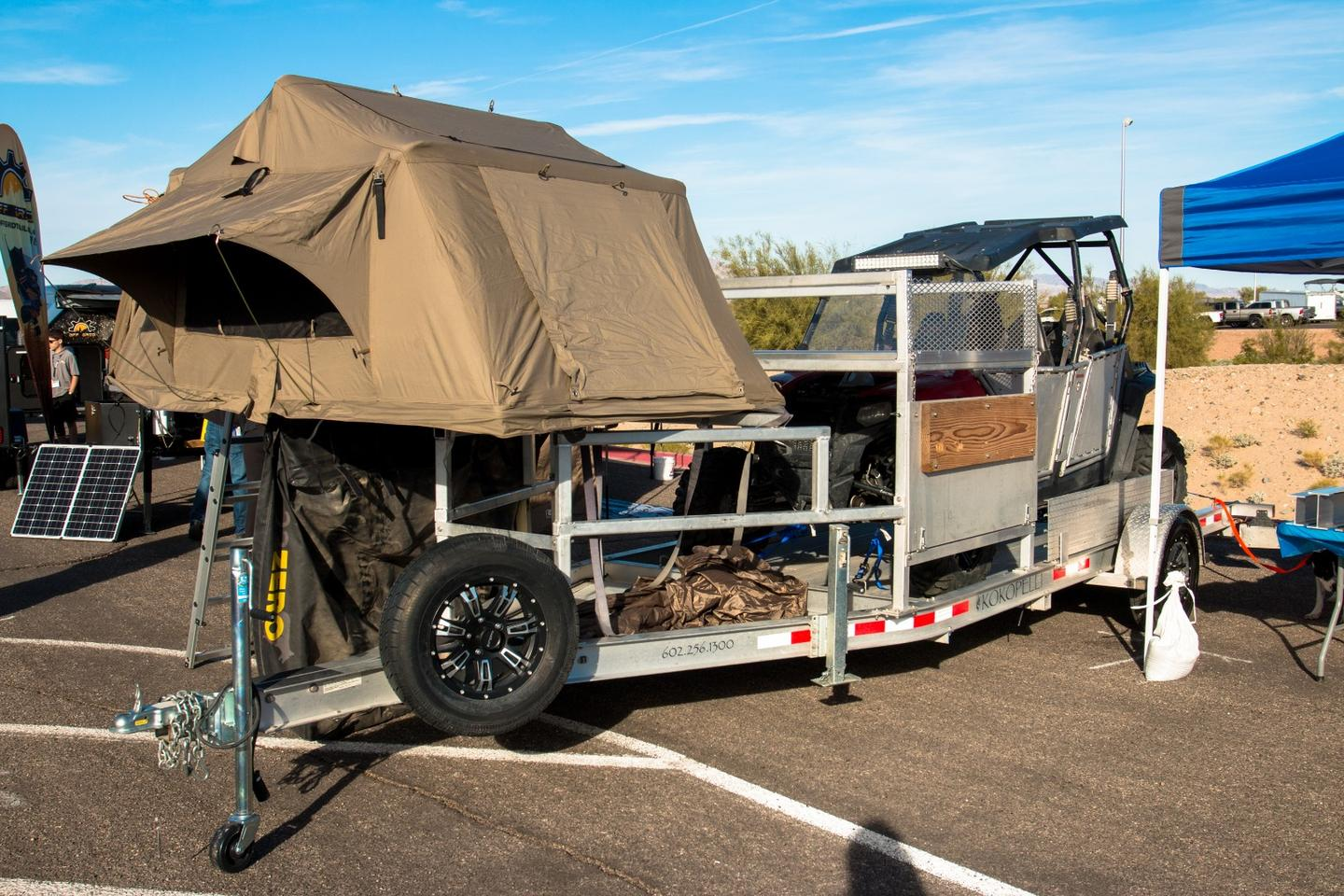 Phoenix-based Kokopelli Trailers specializes in boat and cargo trailers, and here it shows a UTV hauler made into a camper via roof-top tent