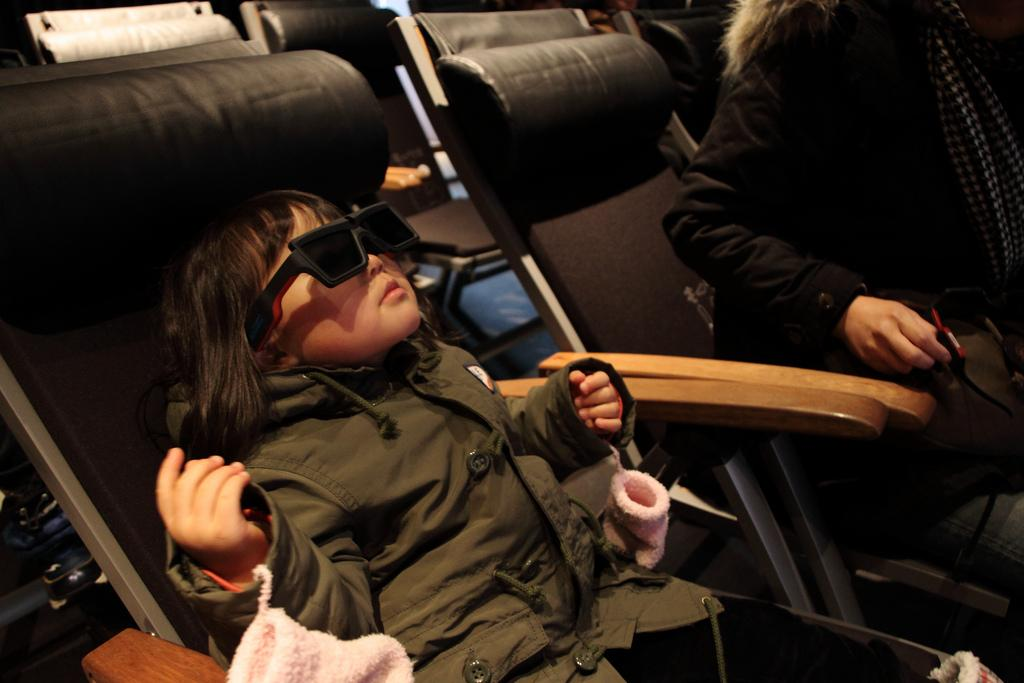 Like her mittens, the 3D glasses might one day be optional (Photo: Miki Yoshihito)