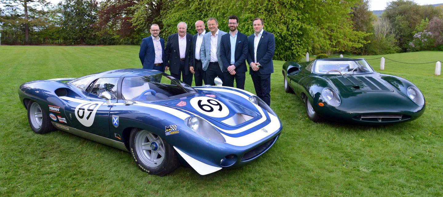 The Ecurie Ecosse team with the LM69