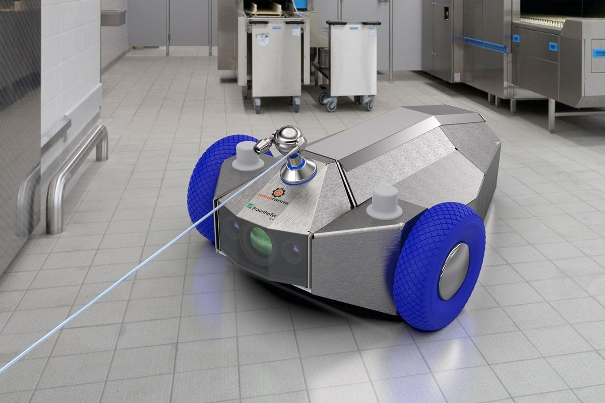 The wheeled version of the robot (pictured here with its arm lowered) is connected to a docking station via a hose