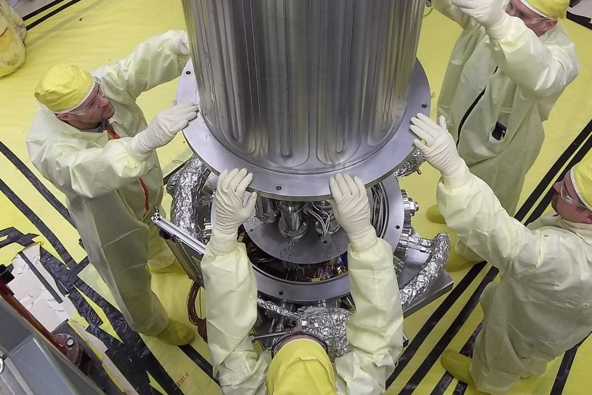 NASA and NNSA engineers lower the wall of the vacuum chamber around the Kilowatt Reactor Using Stirling TechnologY (KRUSTY system)