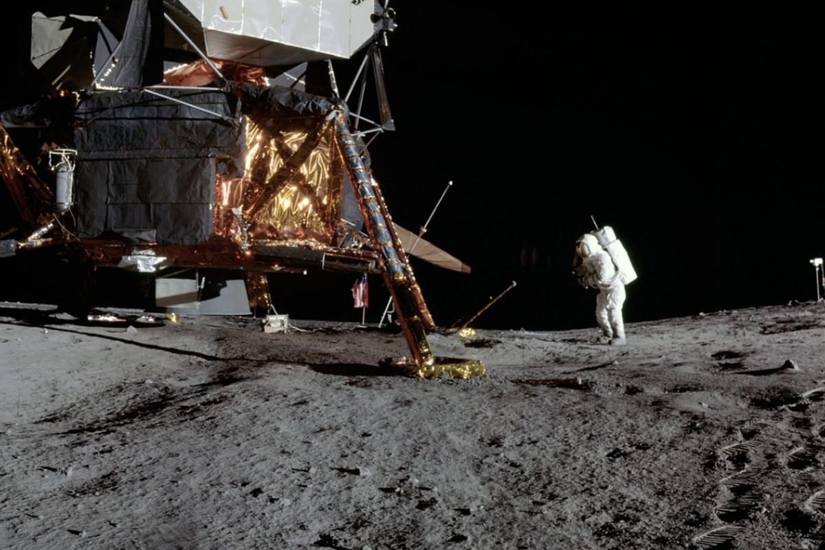 Lunar surface photos taken during Apollo 12 show lunar module pilot Alan L. Bean on the first moonwalk of the mission