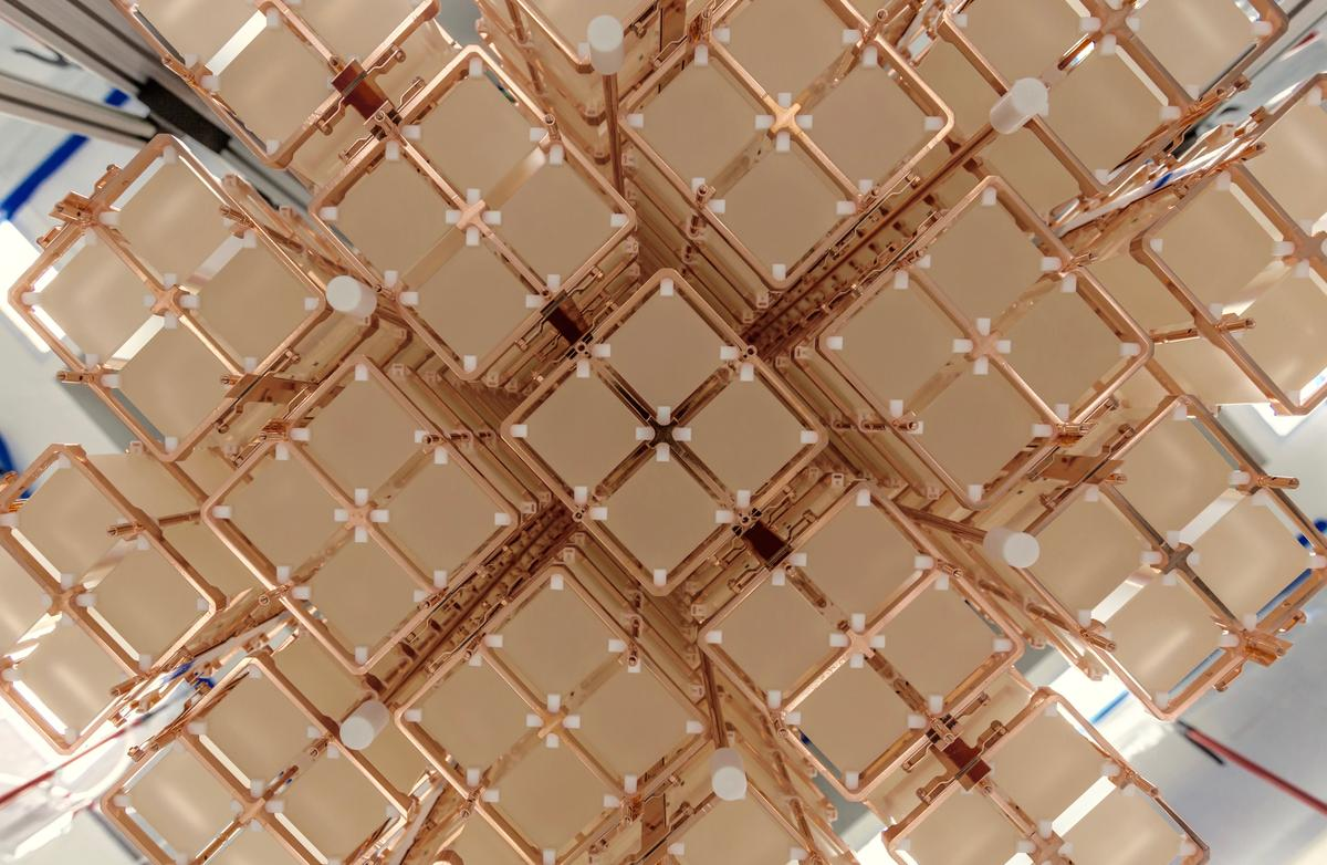 Bottom view of the 19 CUORE towers installed in the cryostat designed to helpexplain why the universe is made mostly of matter