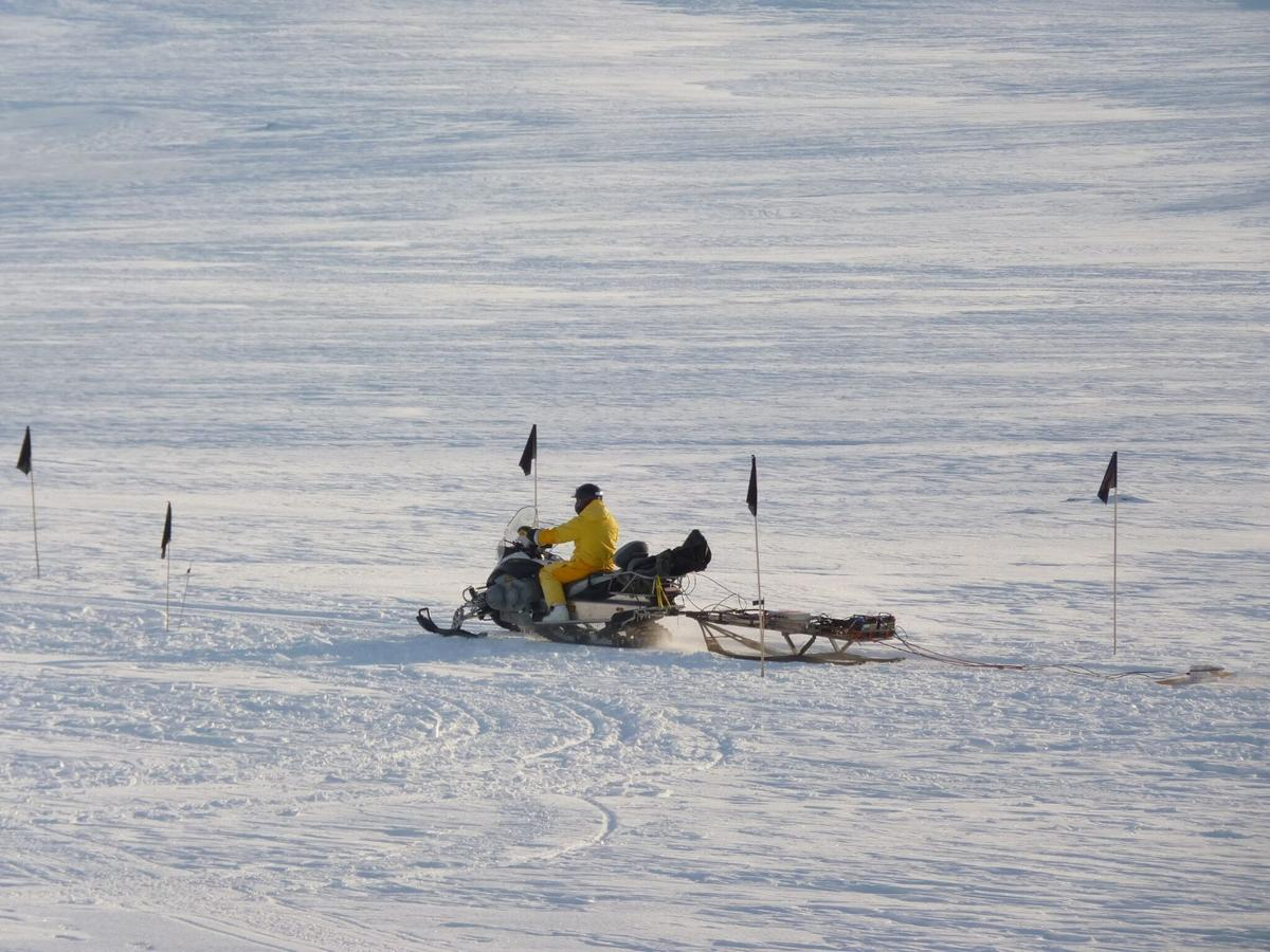 "The purpose built ""metal detector""being dragged behind a Ski-Doo"