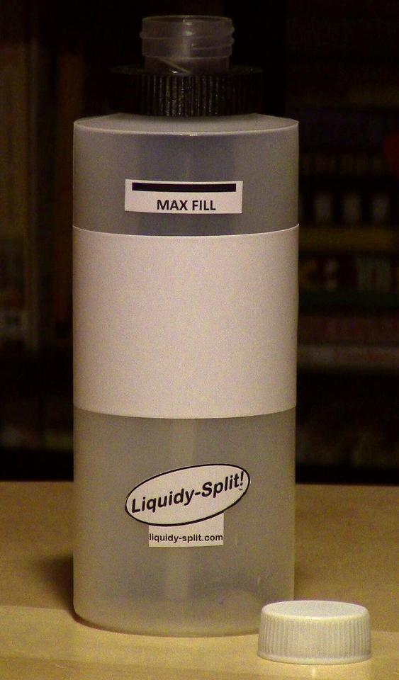 Rather than a normal spout or opening, the bottle has a measuring receptacle on its top