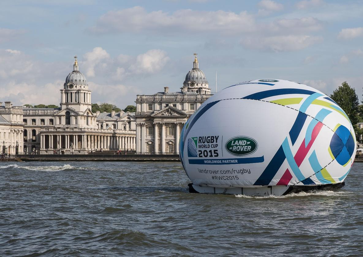 The Defender floated down the Thames in a giant rugby ball before its reveal
