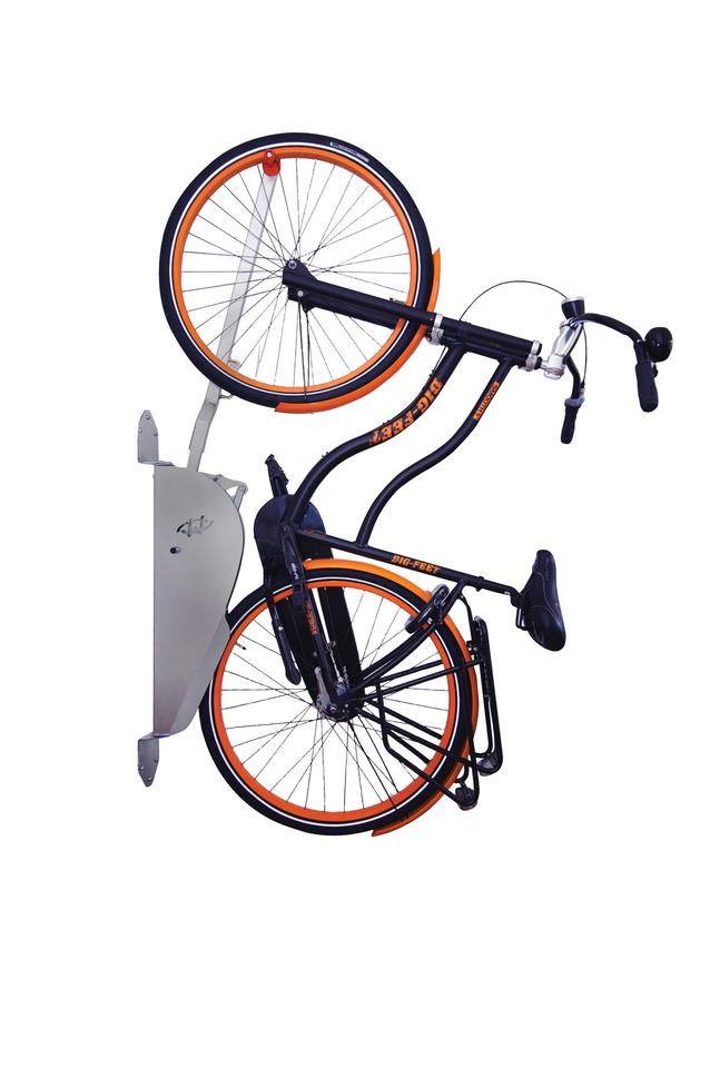 The electricity-free Wheelylift allows the cyclist to hang any model of bicycle from the wall, even in very narrow spaces