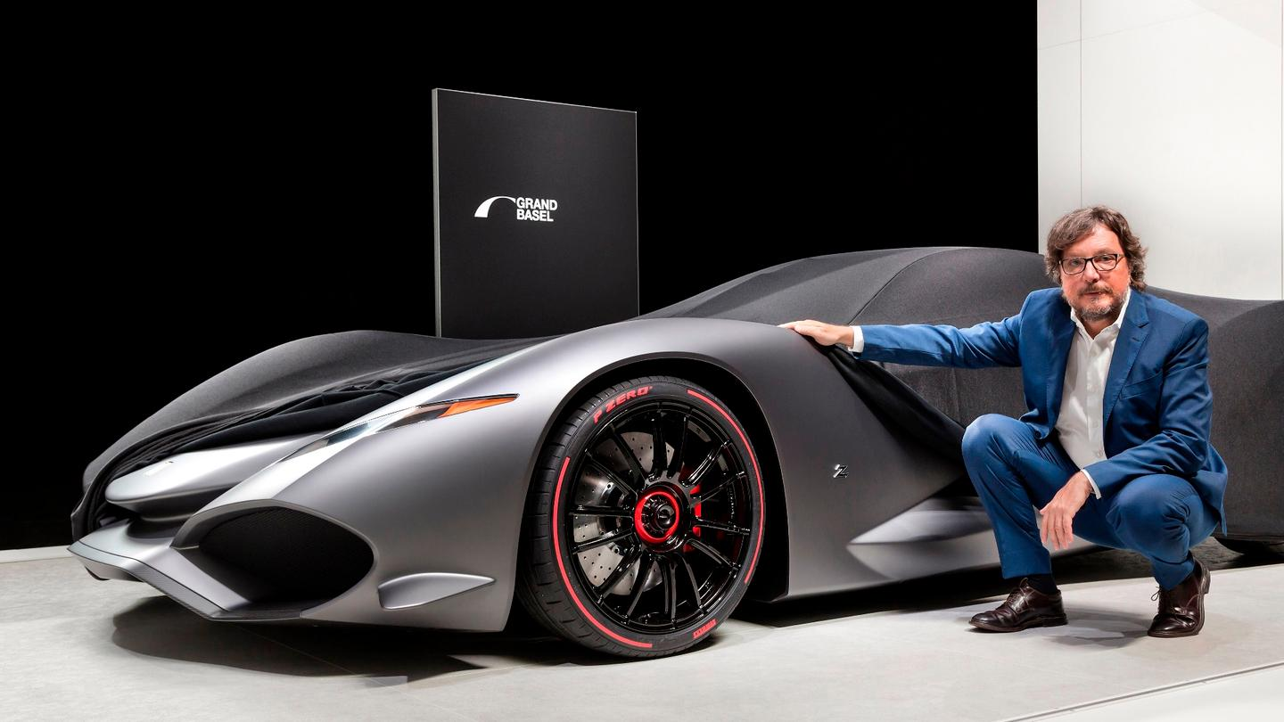 Andrea Zagato and his Zagato IsoRivolta Vision Grand Turismo Concept. The covers were only partially removed, with the full reveal planned for October when it will be available digitally as part of the Sony Playstation game series, Gran Turismo Sport. The concept is expected to be presented in full at Grand Basel 2018.