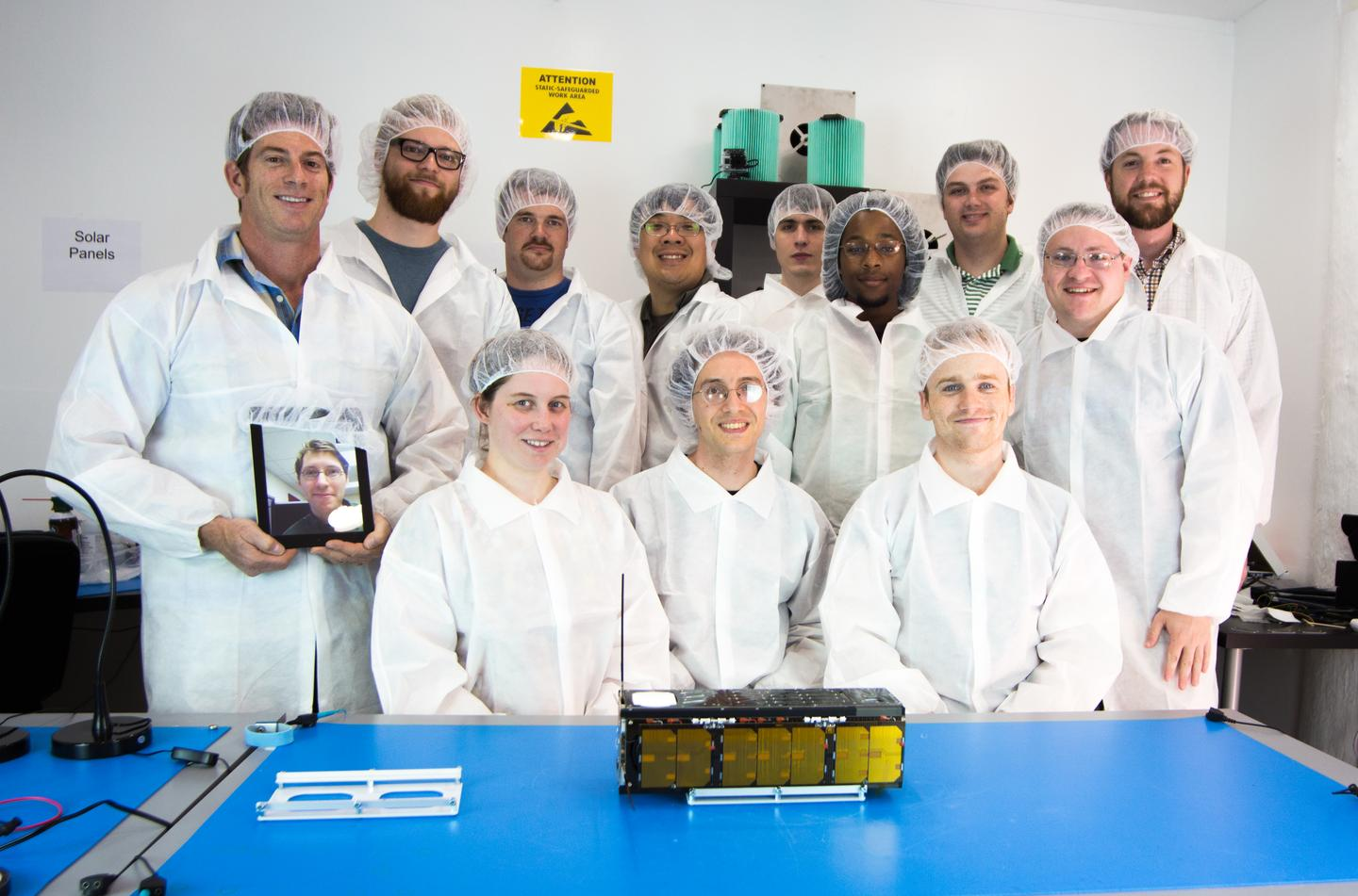 The Spire team, with one of the CubeSats