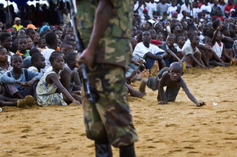 Photo of the Year. A Boy in the Crowd, Monrovia, Liberia