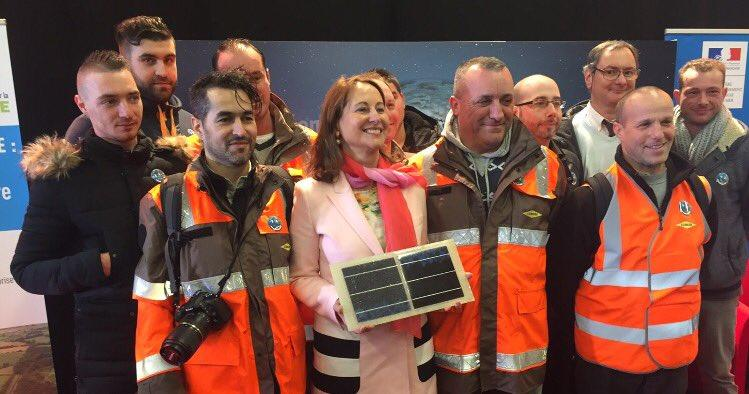 French Minister for the Environment, Energy and Sea Ségolène Royal holding one of the Wattway solar road panels