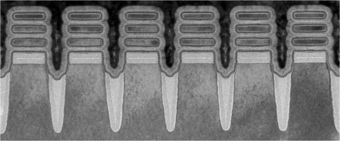A scanning electron microscope image of individual transistors on IBM's new chip, each measuring 2 nanometers wide – narrower than a strand of human DNA