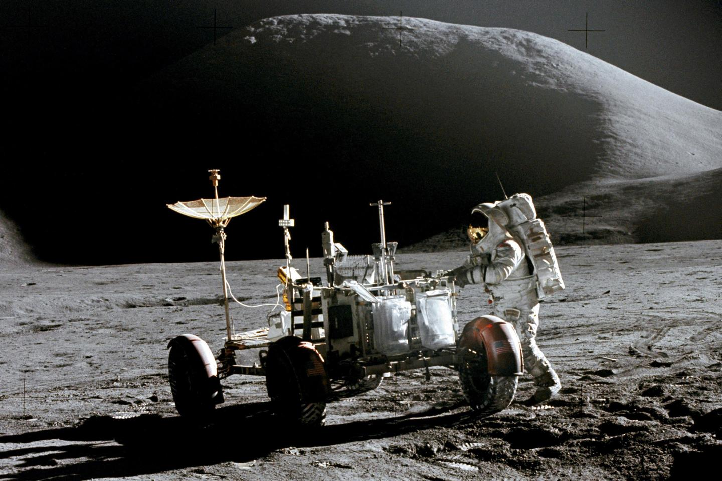 Astronaut James B. Irwin with a not-really-cool-looking lunar rover on the moon in 1971