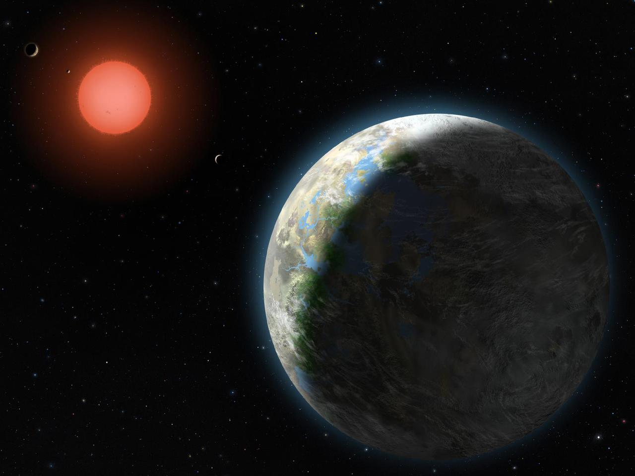 Artist's conception showing the inner four planets of the Gliese 581 system and their host star (Image: Lynette Cook)