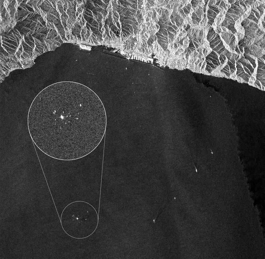 This Sentinel-1A image was acquired on 26 July 2014 over the coast of northwestern Italy while the Costa Concordia cruise ship (enlarged) was being towed towards the city of Genoa (Image: ESA)