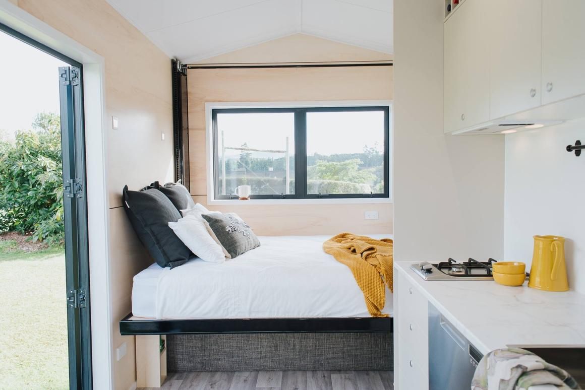 The Camper Tiny House's most notable feature is its pull-down bed which is stowed away near the ceiling when not in use
