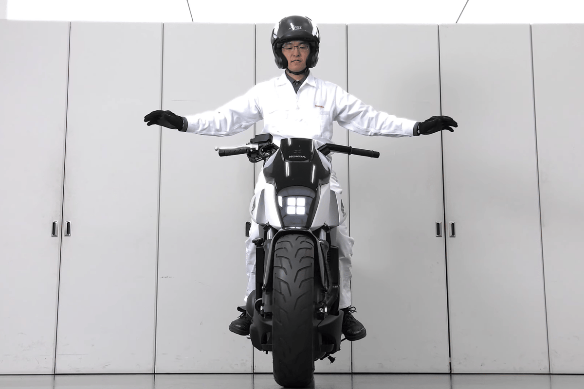 Honda's self-balancing motorcycle:I love to believe Honda R&D guys dress like this all day
