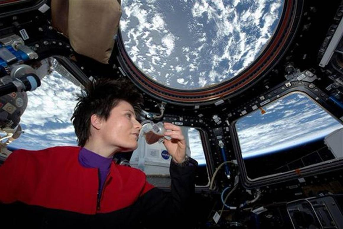 Italian astronaut Samantha Cristoforetti in Star Trek gear, enjoying an espresso