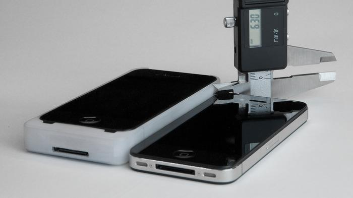 The iExpander side by side with a naked iPhone for thickness comparison