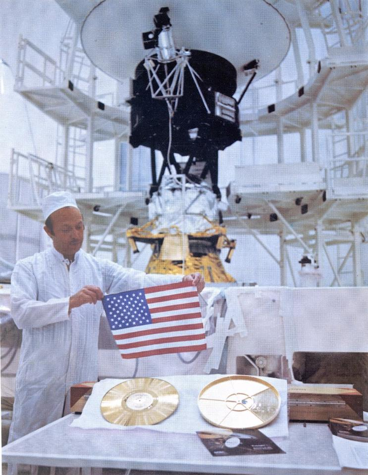 The Voyager golden record and a US flag that also flew on the missions