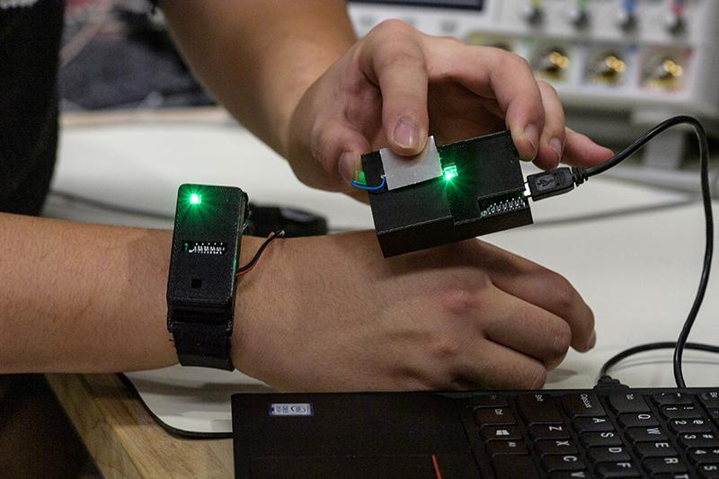 The prototype device is worn on the wrist and sends data via the human body using low-frequency electromagnetic signals