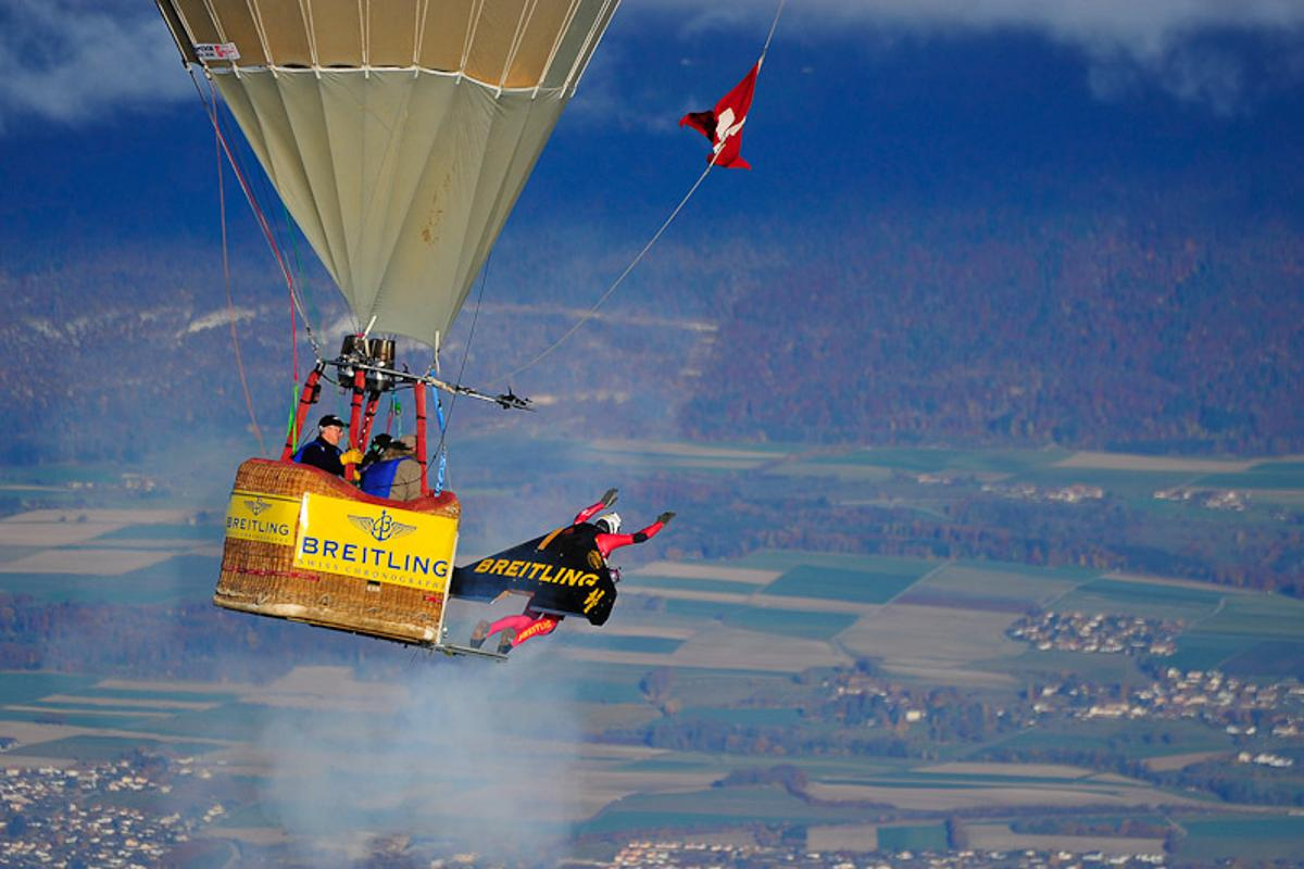 Swiss 'Jetman' Yves Rossy has successfully performed two aerial loops, using his unique strap-on jet-powered wing