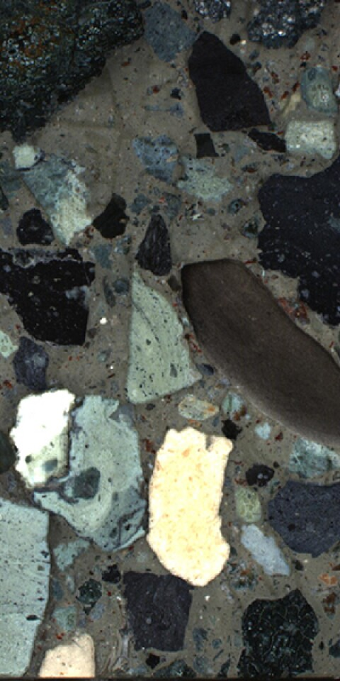 A section of the drilled rock sample taken from the Chicxulub crater, showing different types of rock that were washed into the crater following the impact