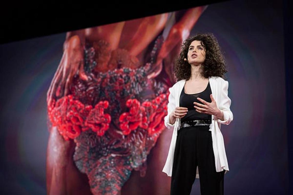 MIT professor Neri Oxman has displayed what is claimed to be the world's first 3D-printed photosynthetic wearable embedded with living matter