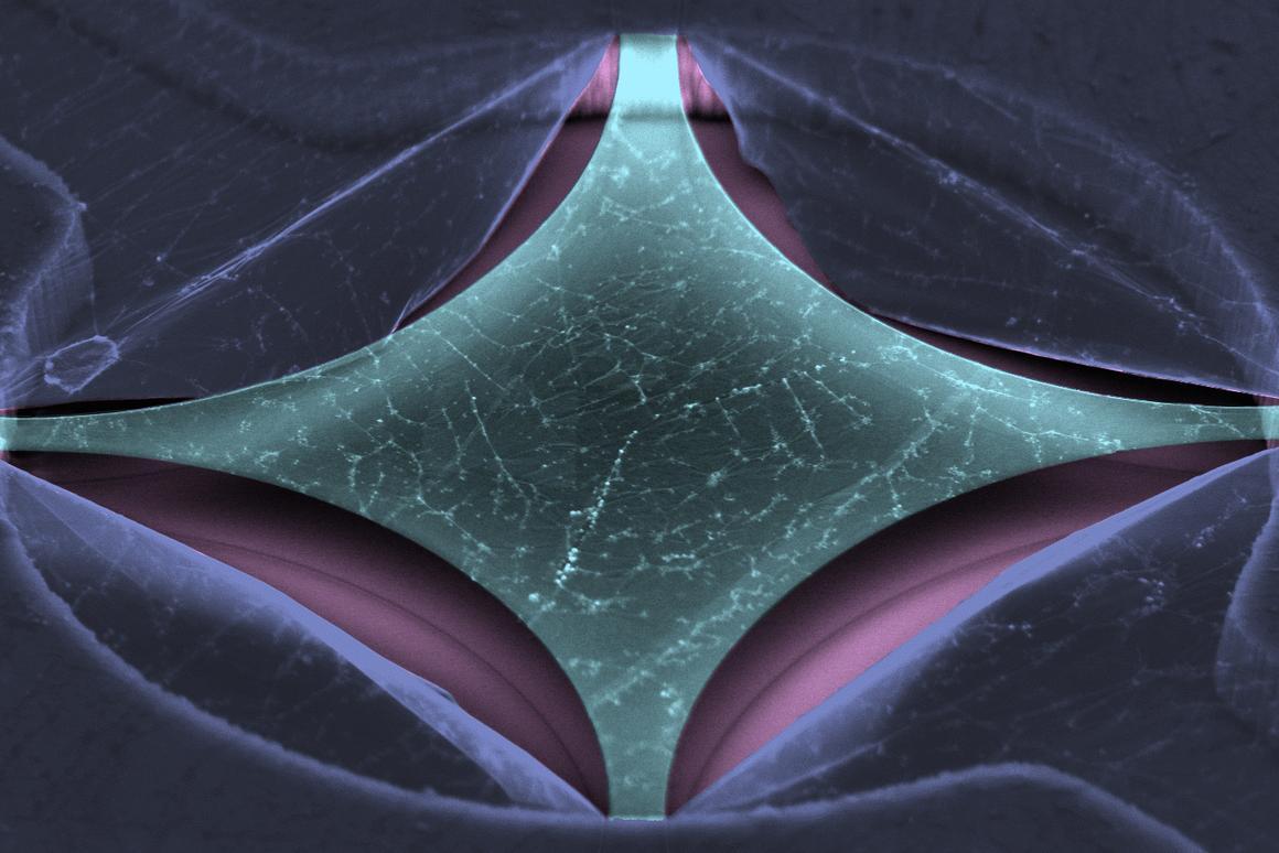 A false-color microscope image of the graphene nanomechanical bolometer