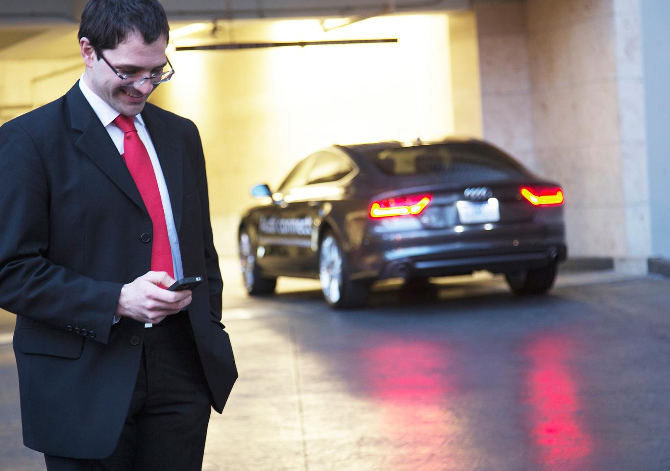 Audi's piloted parking project uses a smartphone app, wireless communications and advanced vehicle sensors for self-parking