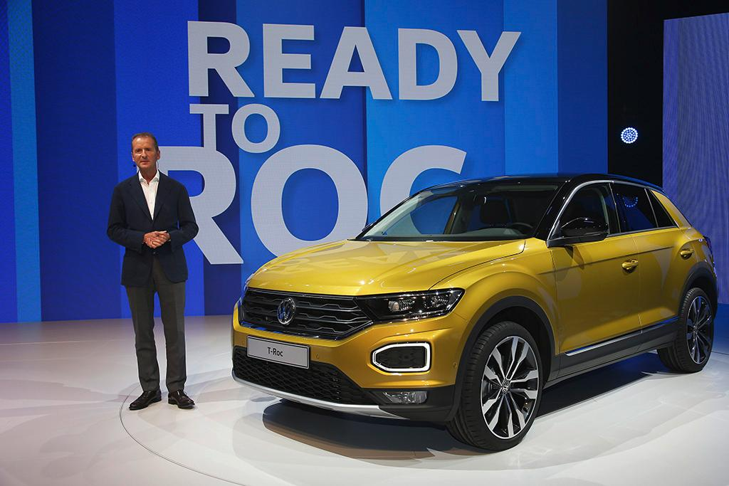 Dr. Herbert Diess, Chairman of the Board of Management of Volkswagen Passenger Cars, shows thenew T-Roc