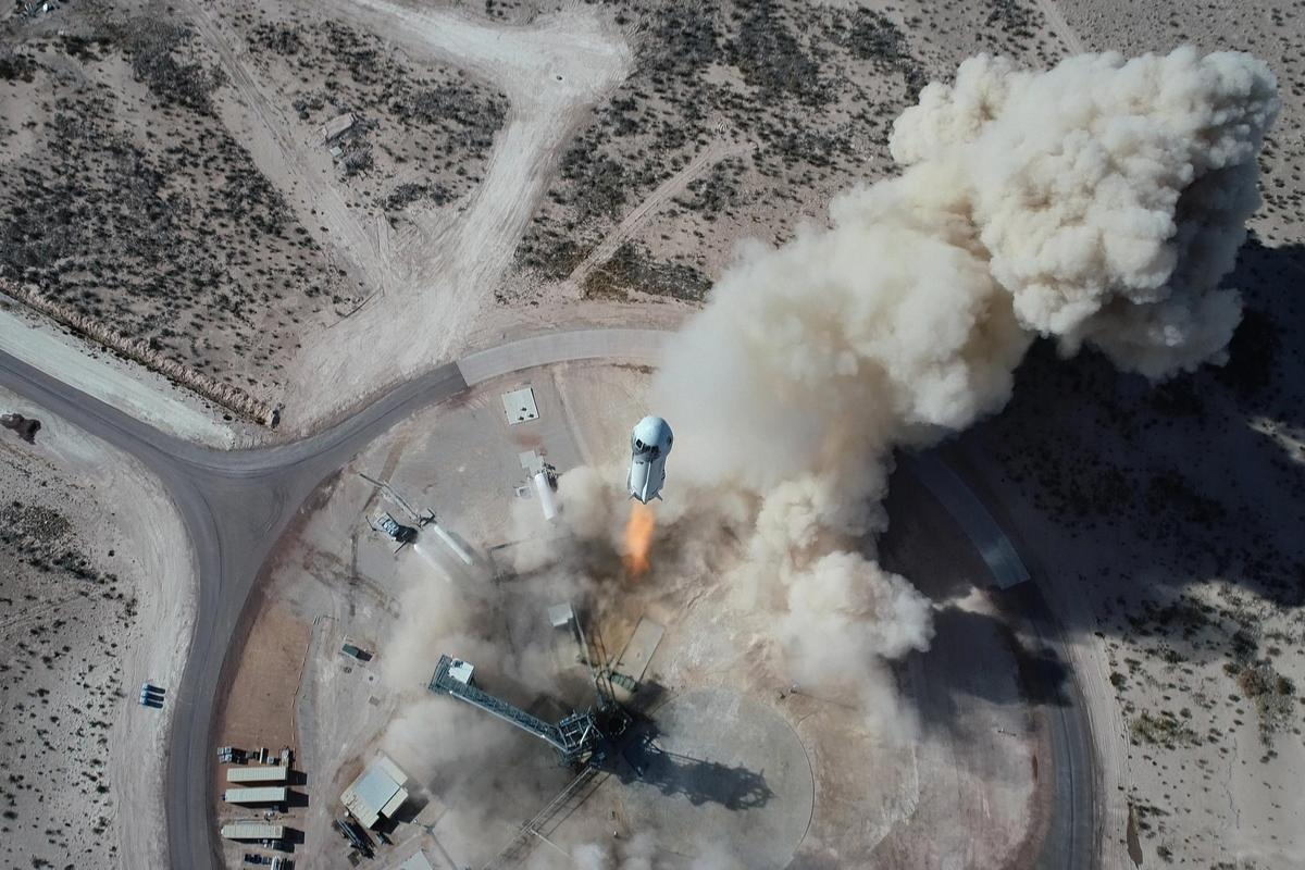 The New Shepard rocket lifts off on a recent test flight