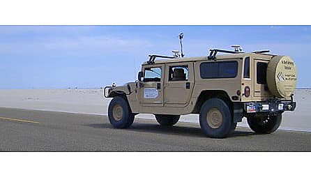The Kairos Autonomi Pronto4 Agnostic Autonomy system is a strap-on kit that adds self-driving or remote-control capability to any steering wheel based vehicle - in this case a HMMWV