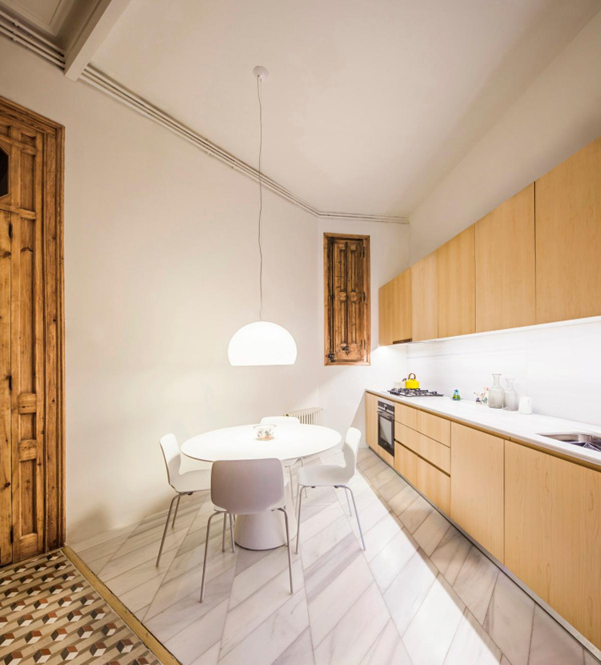 "The Cabinet Studio Apartment is filled with specifically designed and positioned elements such as contrasting 3D geometric and mosaic tile flooring; white walls and a small elevated ""door"""