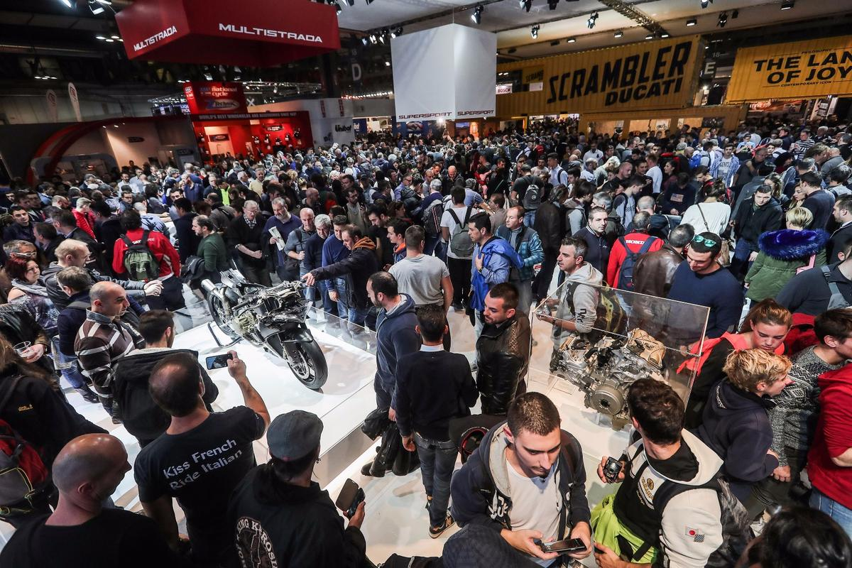 Huge crowds roamed EICMA's six halls on the first public day, with most rushing to Ducati's boothfirst